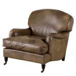 Кожаное кресло в красивом оливковом цвете