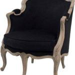 Мягкое кресло, оформленное в черном цвете