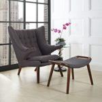 Серое кресло в интерьере дома