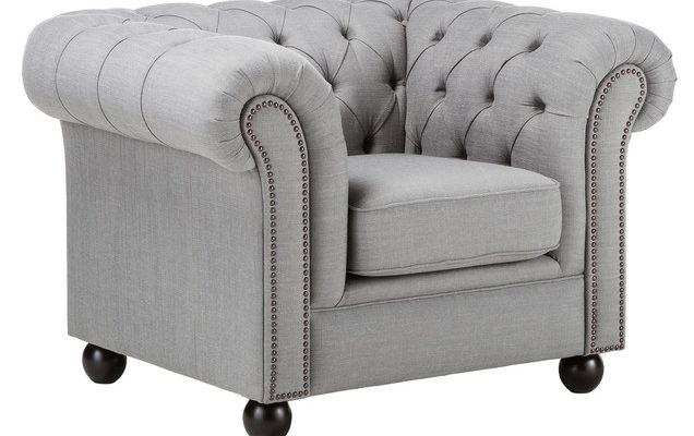 Стильный дизайн кресла, оформленного в сером цвете